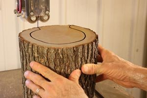 Use a bandsaw to remove center of birdfeeder.