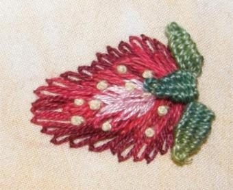 A strawberry worked in lazy daisy stitch